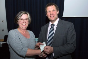 WCDFAS Chair Liz Woods presents a donation to Martin Tucker, Director of the Penwith College site.