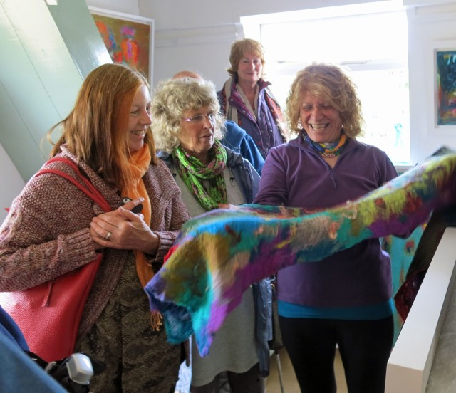 Basma Ashworth shows some of her incredible textiles to Vicki Thomson and Rosalind Clough.