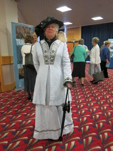 The people you meet at the AGM! Here's a woman modeling the costumes made for Polesden Lacey by her DFAS's heritage volunteer group.